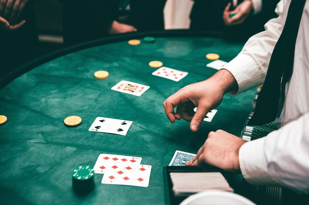 blackjack players and cards on table